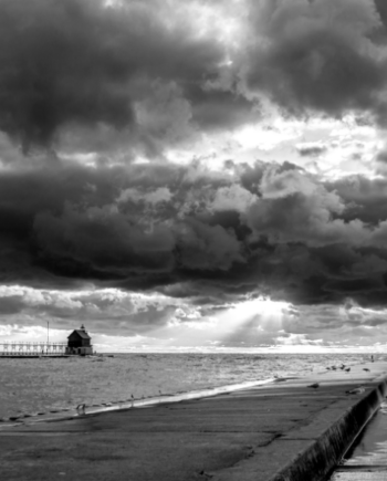 north and south pier sunset in black and white