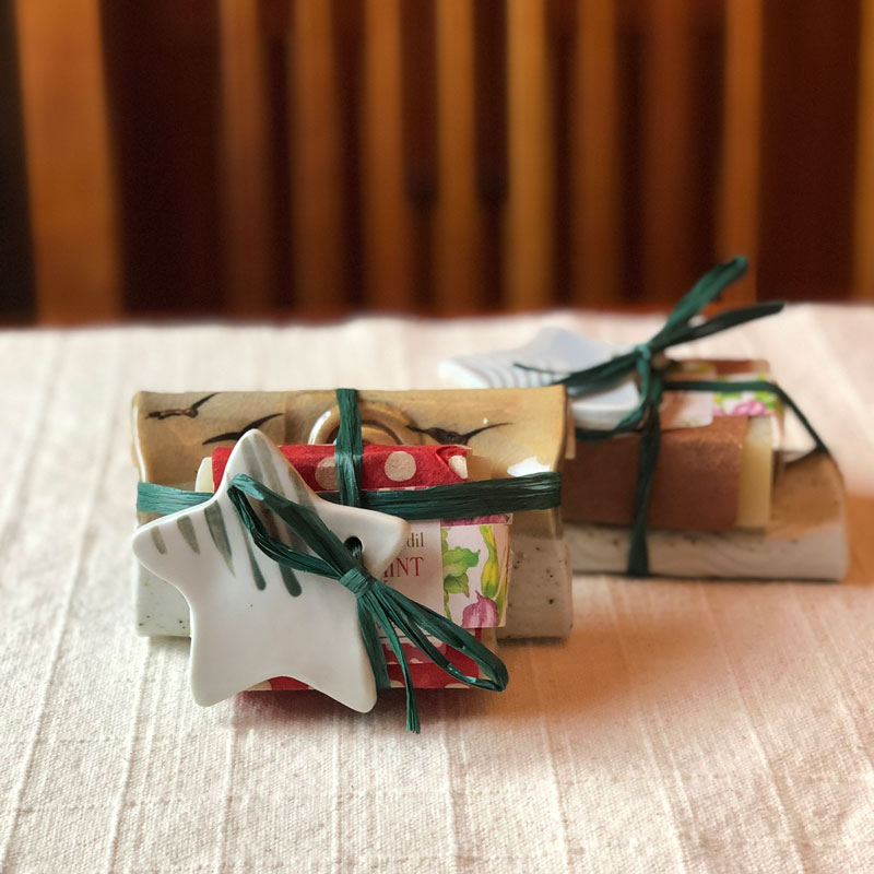 Hostess gifts combining a handmade soap dish or spoon rest with a soy candle and ornament