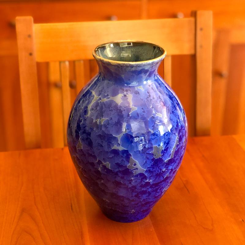 Dk Cobalt Crystalline Vase sitting on a table