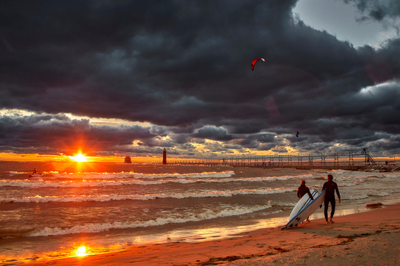 photograph of sunset with kiteboard surfers in Grand Haven