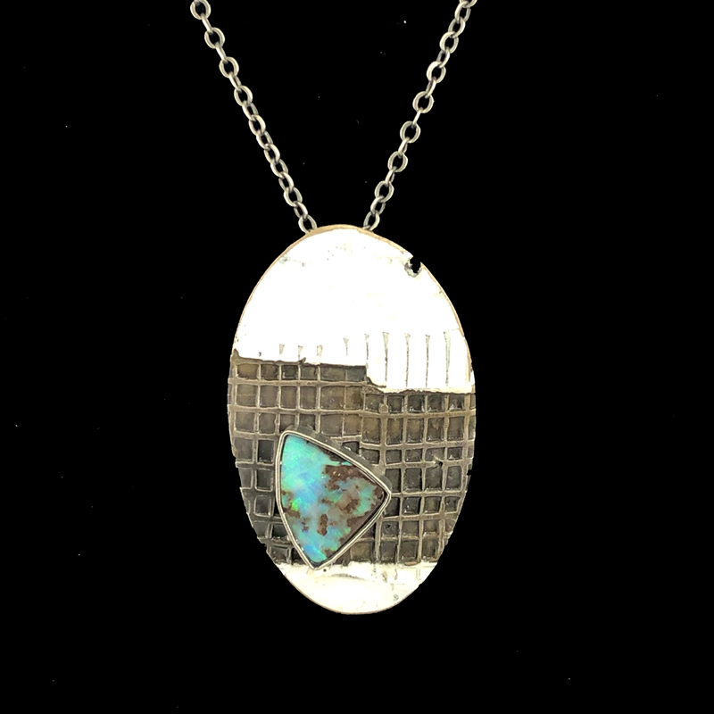handmade enameled steel pendant with a boulder opal stone